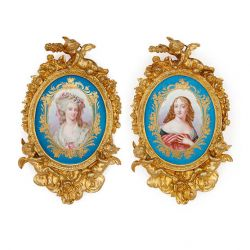 Pair of Sèvres style porcelain plaques in ormolu frames